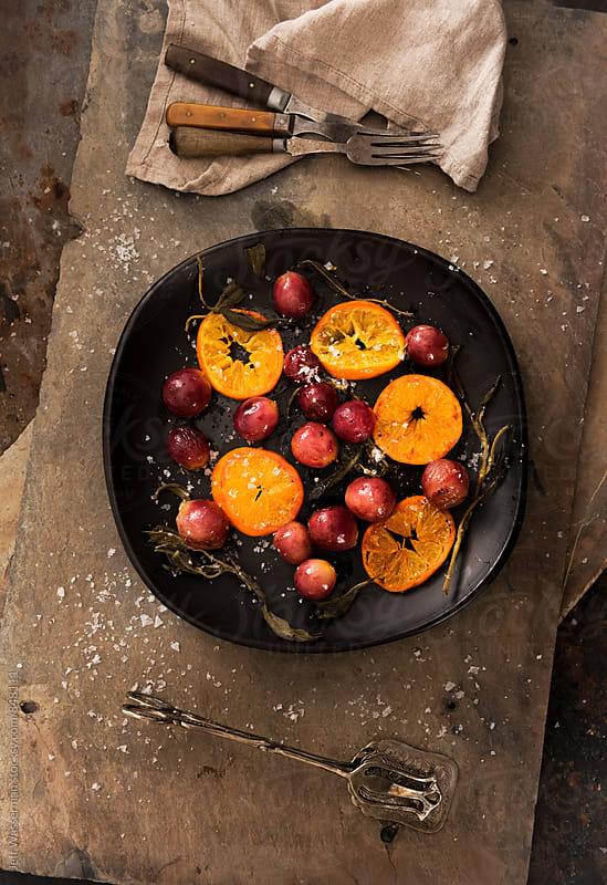 Roasted Grapes and Clementine Oranges  by Jeff Wasserman for Stocksy United
