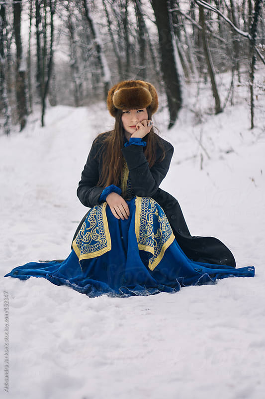Beautiful girl in the blue dress posing in the woods by Aleksandra Jankovic for Stocksy United