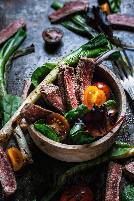 Grilled steak salad. by Darren Muir for Stocksy United