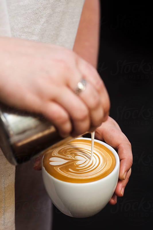Pouring a coffee by Reece McMillan for Stocksy United
