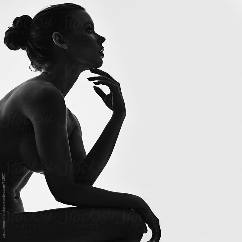 Silhouette of elegant nude woman by Jacob Lund for Stocksy United