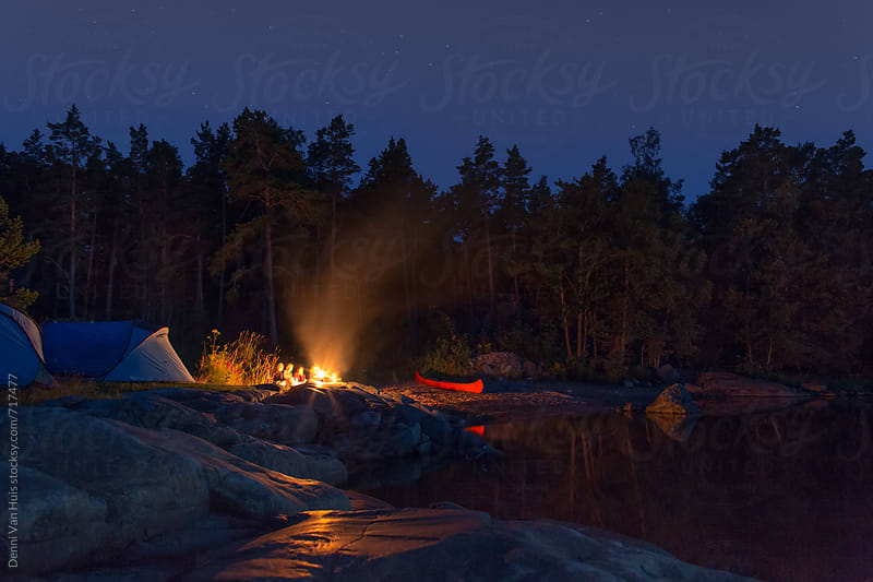 Camping with tents in nature along the sea at night under the stars by Denni Van Huis for Stocksy United