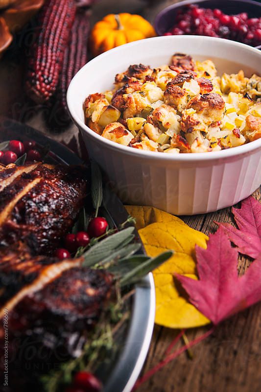 Thanksgiving: Focus On Apple Bacon Stuffing On Dinner Table by Sean Locke for Stocksy United