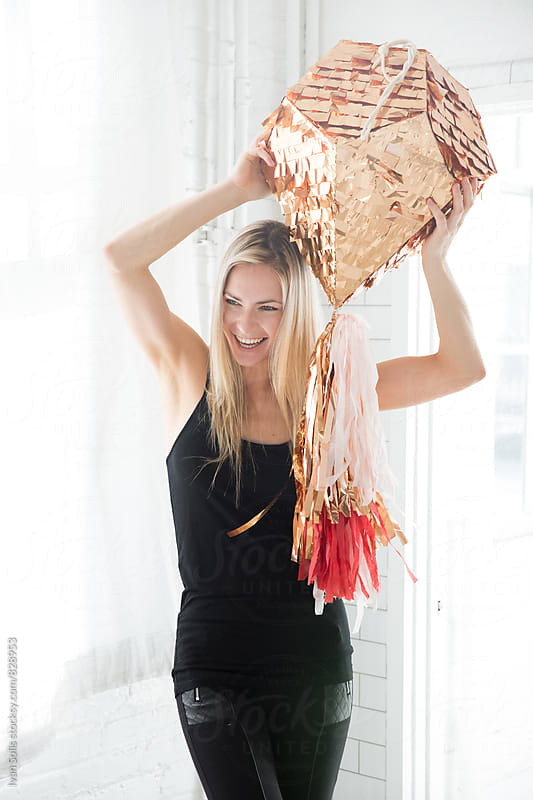Woman with diamond pinata  by Ivan Solis for Stocksy United