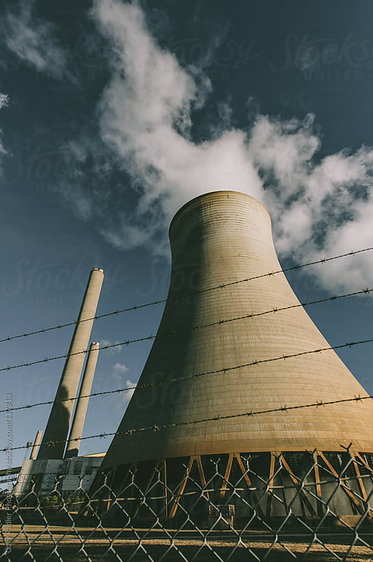 Looking up at a Cooling Tower (vertical composition) by Gary Radler Photography for Stocksy United