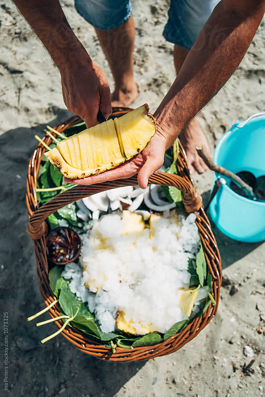 Food: Cocco bello e ananas at the beach by Ina Peters for Stocksy United