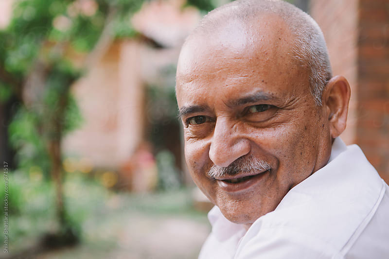 Smiling old man of South Asian descent. by Shikhar Bhattarai for Stocksy United