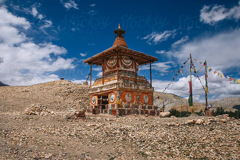 Bright colorful chorten of Upper Mustang typify the essence of the colors and textures of the lands. by Shikhar Bhattarai for Stocksy United