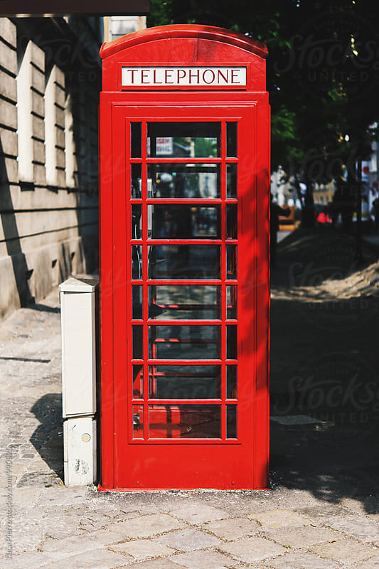 red telephone box by Luca Pierro for Stocksy United