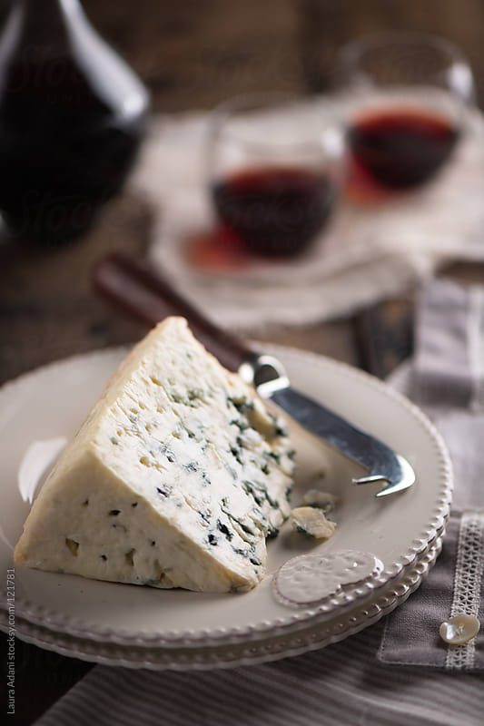 a slice of roquefort  by Laura Adani for Stocksy United