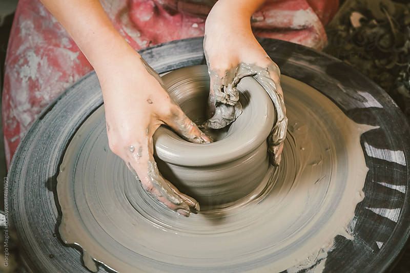 Woman Crafting Ceramics on Pottery Wheel by Giorgio Magini for Stocksy United