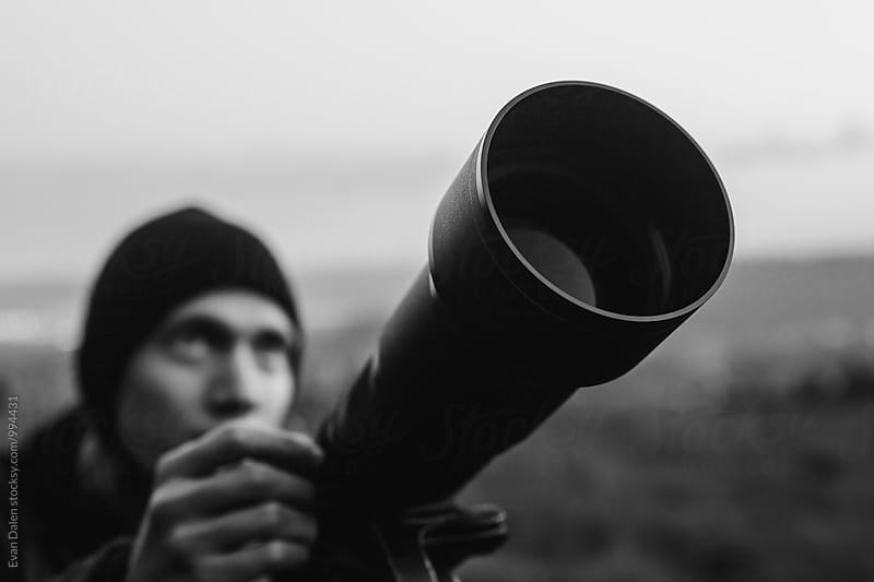 Man Using Telescope  by Evan Dalen for Stocksy United