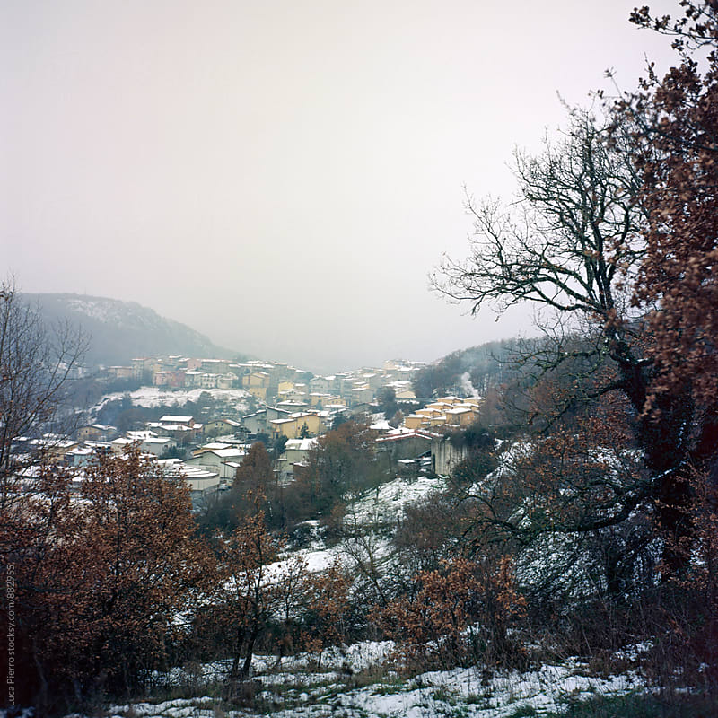 Small village under the snow by Luca Pierro for Stocksy United