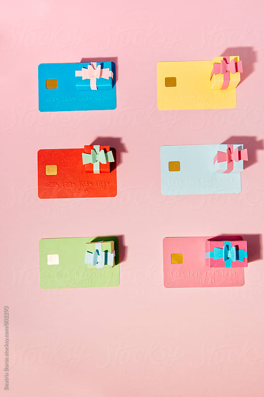 6 small gift boxes with six credit cards in two columns by Beatrix Boros for Stocksy United