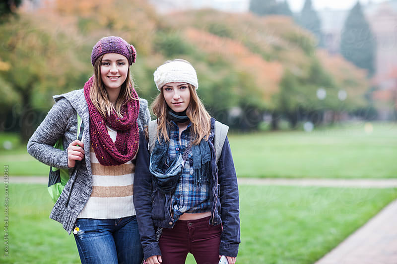 Two female college students on campus by Suprijono Suharjoto for Stocksy United