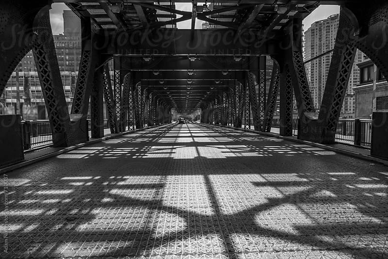 Old steel bridge in a city, Chicago by Adam Nixon for Stocksy United