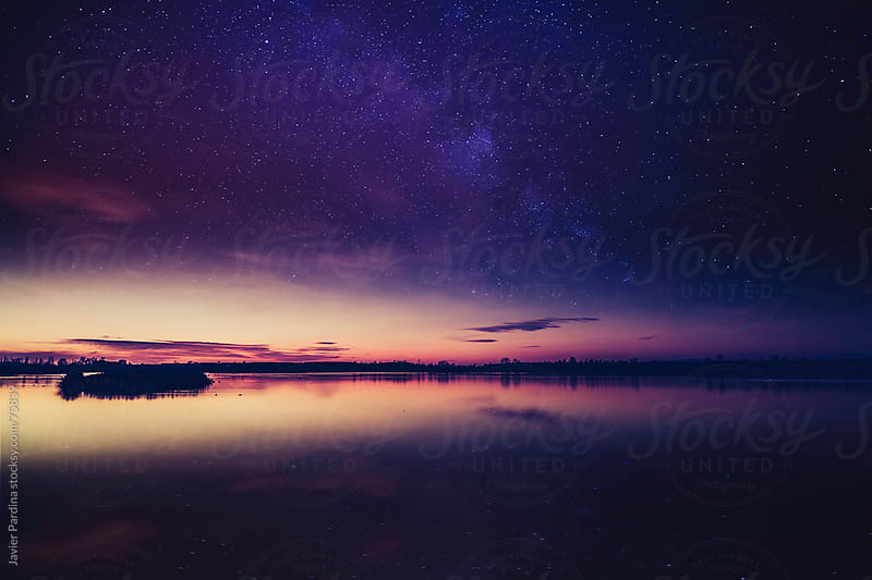 Lake at sunset, the first stars begin to appear  by Javier Pardina for Stocksy United