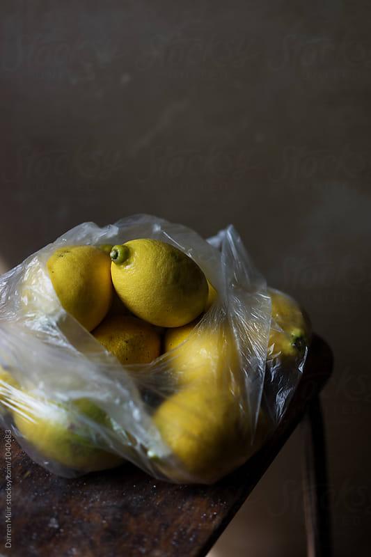 A bag of lemons. by Darren Muir for Stocksy United
