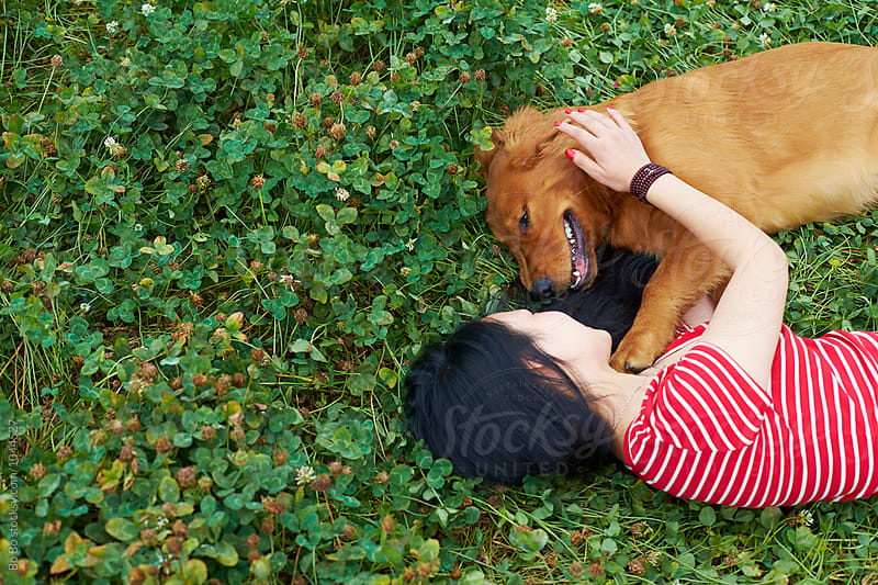 happy little asian girl with her dog outdoor by Bo Bo for Stocksy United