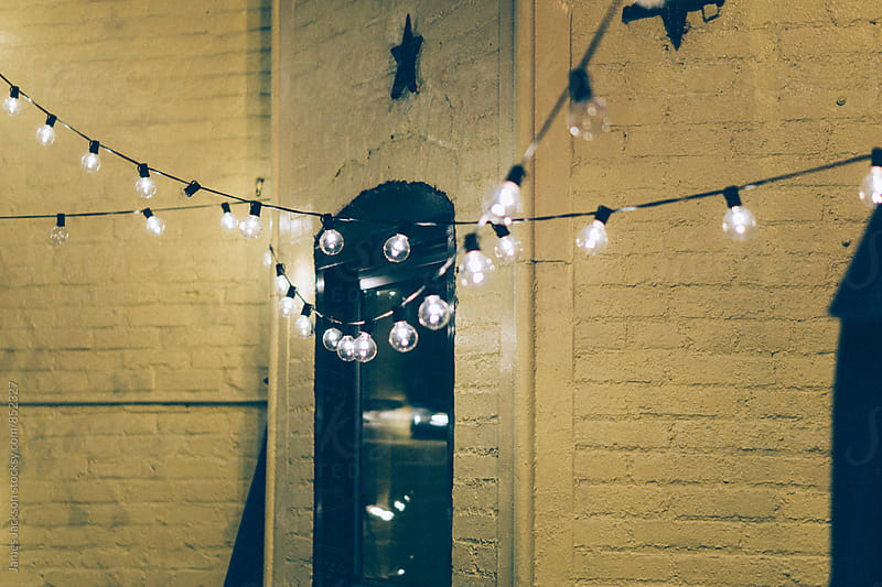 Restaurant patio lights make a smiley face. by James Jackson for Stocksy United
