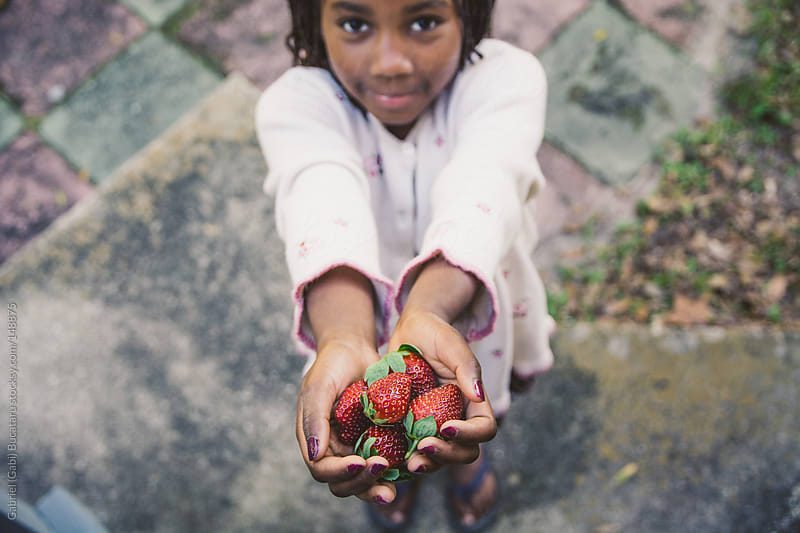 Girl With Strawberries by Gabriel (Gabi) Bucataru for Stocksy United