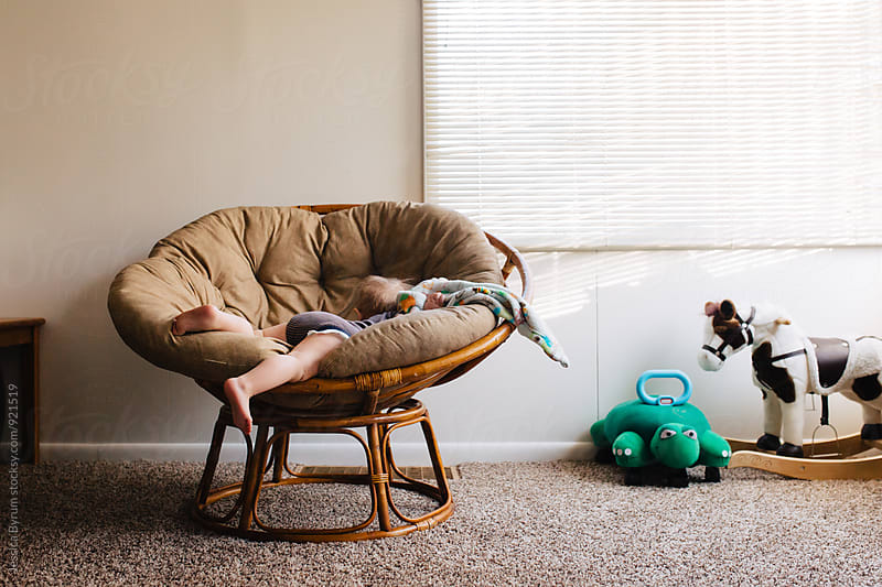Toddler stuck in papasan chair by Jessica Byrum for Stocksy United
