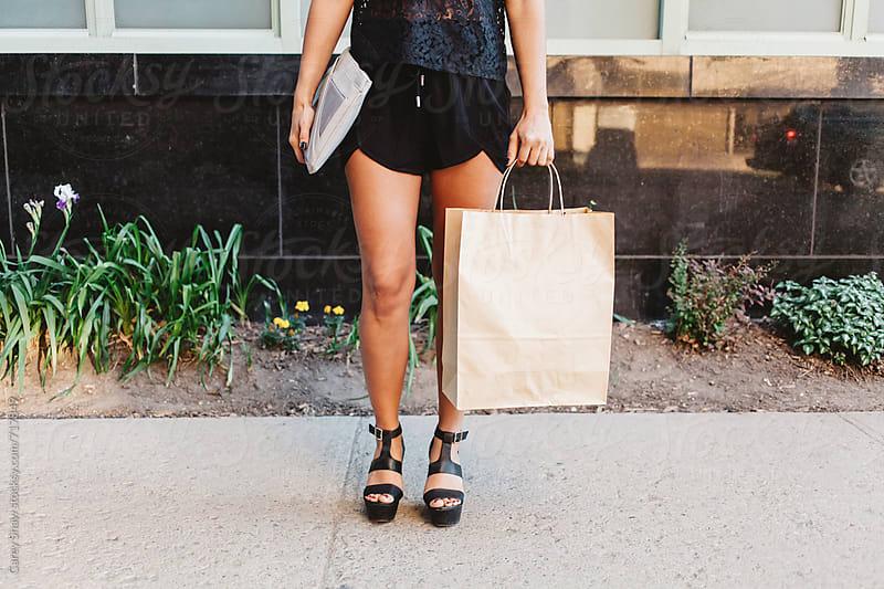 Stylish female holding shopping bag by Carey Shaw for Stocksy United