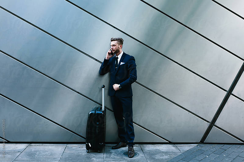 Young Businessman Travelling with His Lagguage  by Mattia Pelizzari for Stocksy United