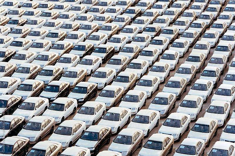 Middle East, Oman, Muscat, Port of Oman, newly imported cars on the dock by Gavin Hellier for Stocksy United
