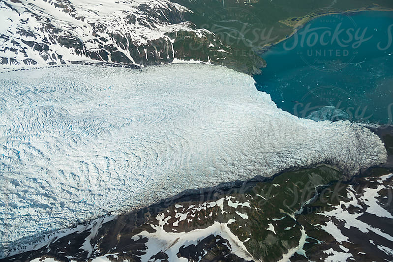 Aerial Perspective of Glacier Meeting an Ocean by Willie Dalton for Stocksy United