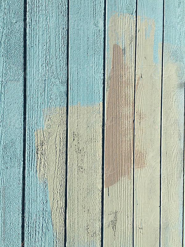 Paint covering graffiti markings on urban fence by Paul Edmondson for Stocksy United