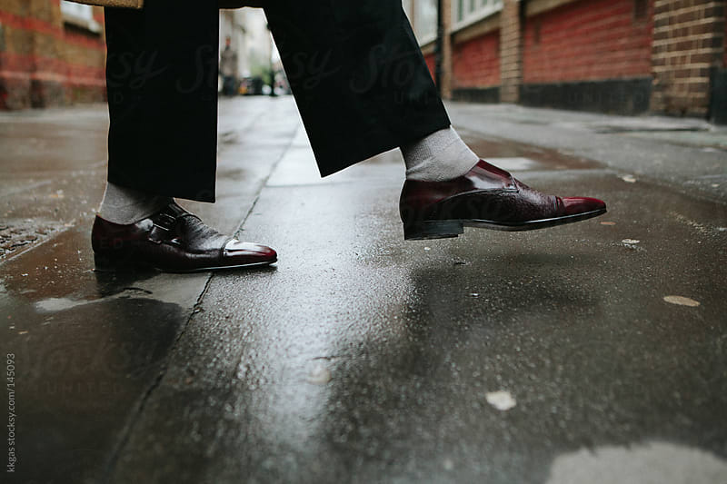 Shoes in the rain . by kkgas for Stocksy United