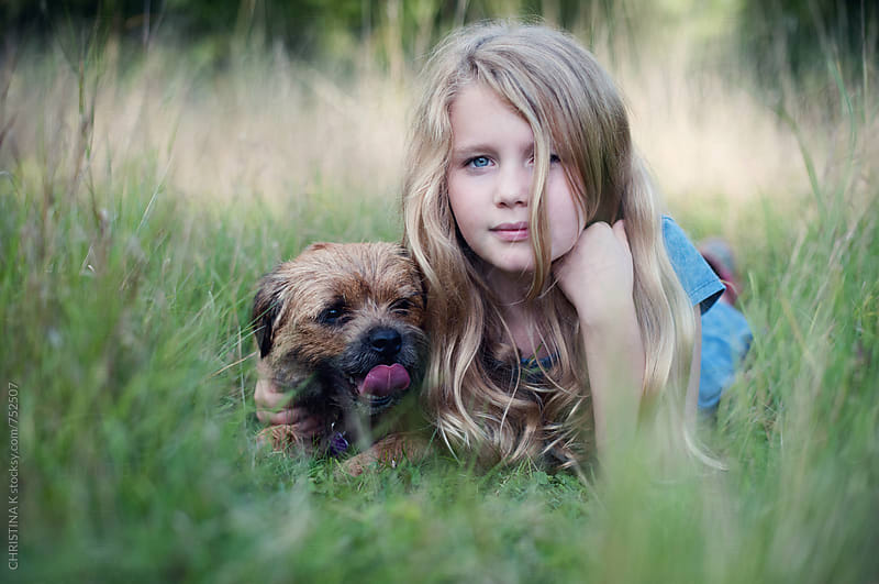 Girl and her dog by CHRISTINA K for Stocksy United