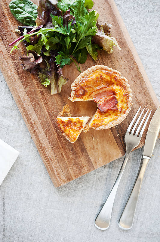 quiche with salad by Gillian Vann for Stocksy United