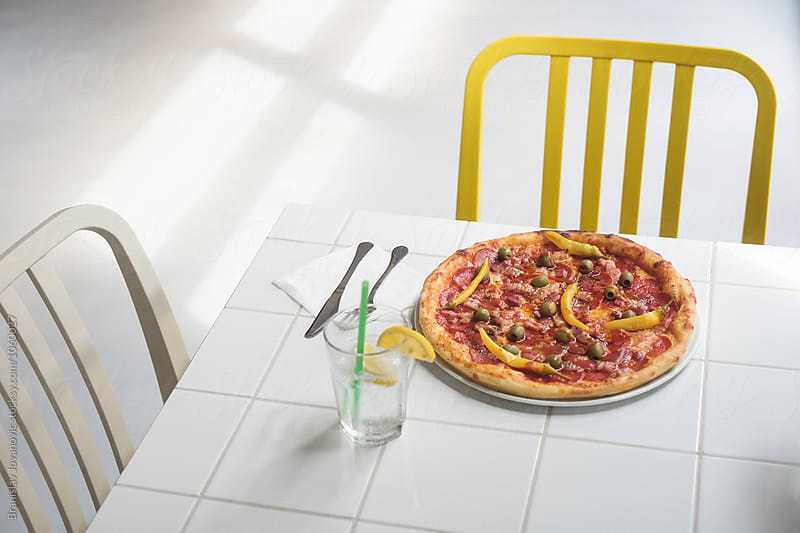 Delicious Pepperoni Pizza on the Table at the Restaurant by Branislav Jovanović for Stocksy United