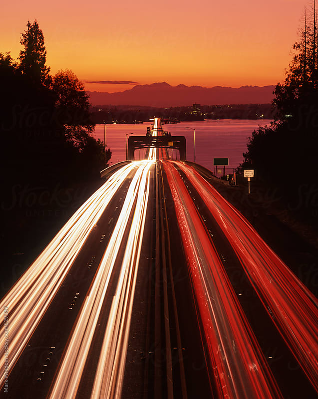 Streaking traffic lights at dusk by Mark Windom for Stocksy United