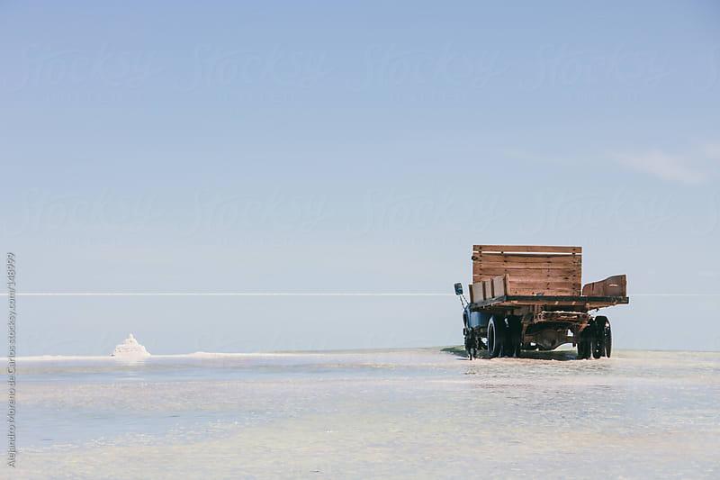 Old truck on salt flat. Uyuni, Bolivia travel by Alejandro Moreno de Carlos for Stocksy United