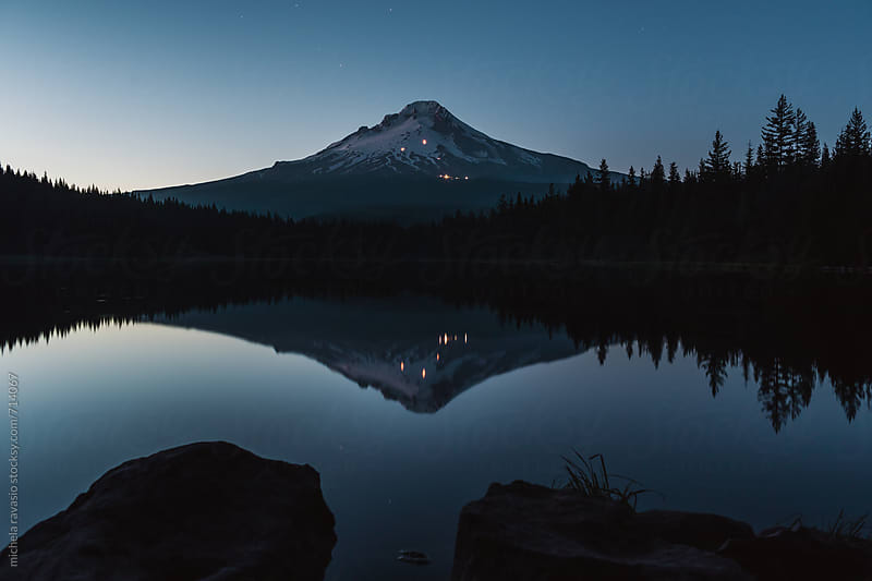 Mt Hood reflected in Trillium Lake at night by michela ravasio for Stocksy United
