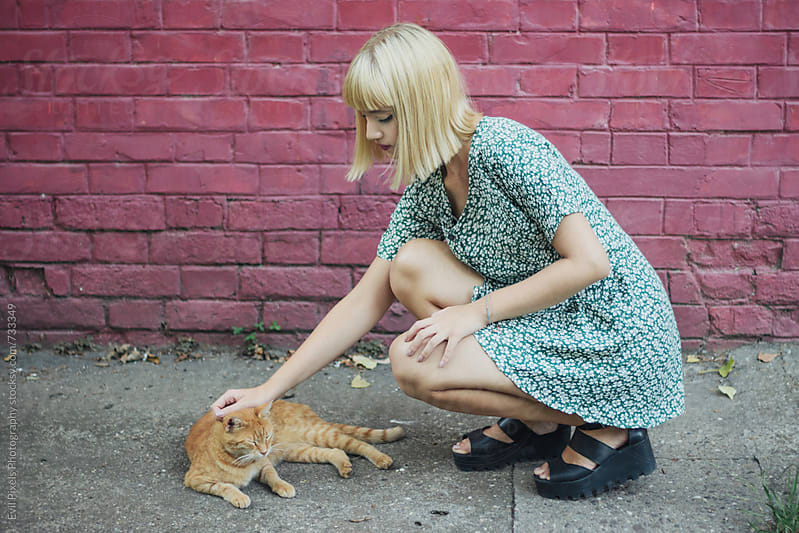 Portrait of a young beautiful female model with cat by Evil Pixels Photography for Stocksy United