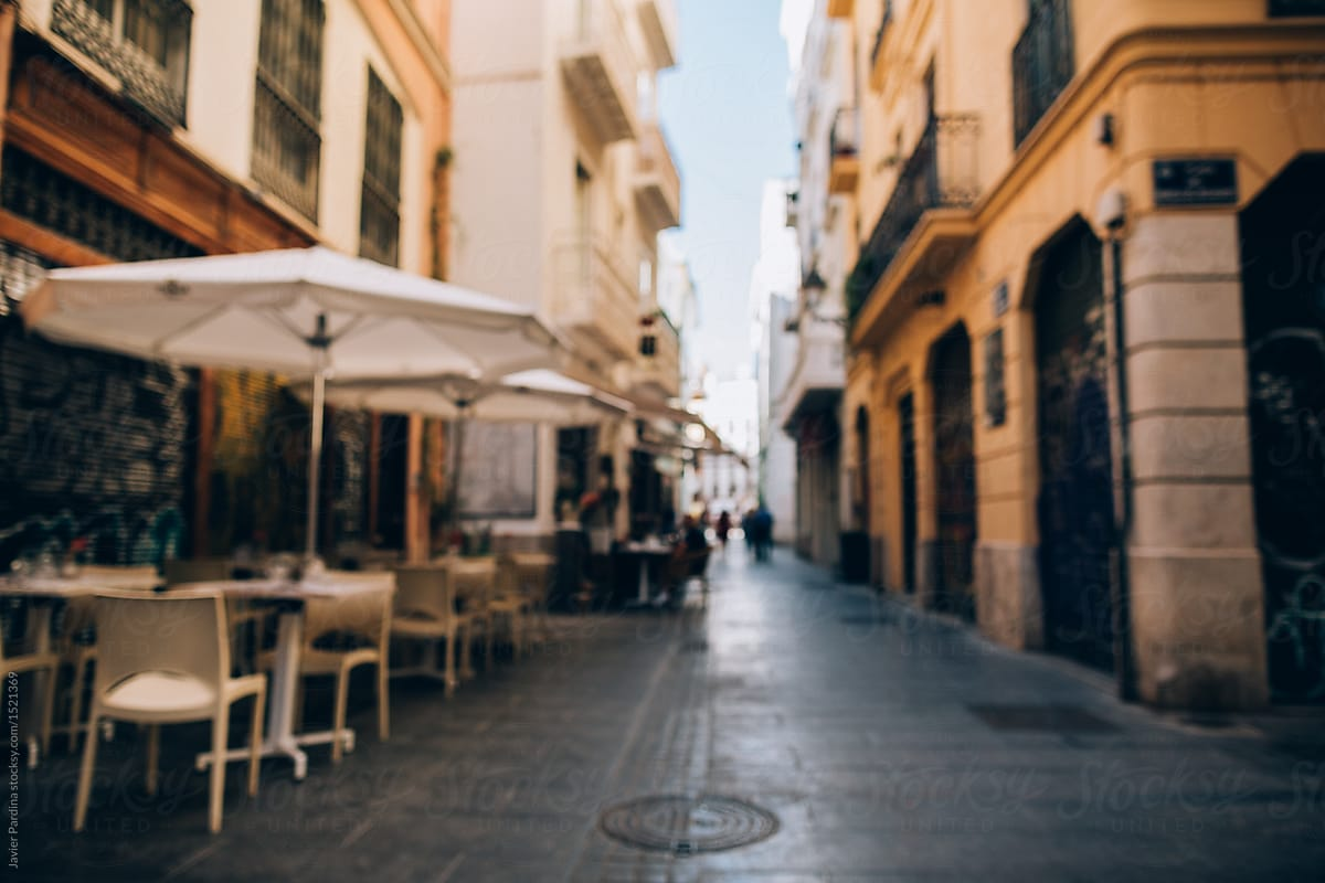 unfocused empty bar at empty street in valencia spain stocksy united
