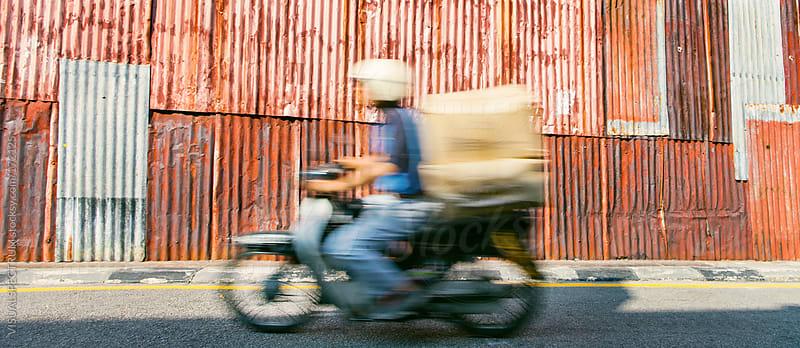 Defocused Man On Motorbike by VISUALSPECTRUM for Stocksy United