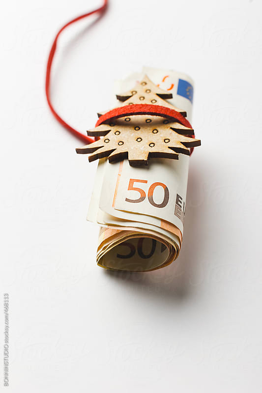 Fifty euro banknotes for spend at Christmas gifts.  by BONNINSTUDIO for Stocksy United