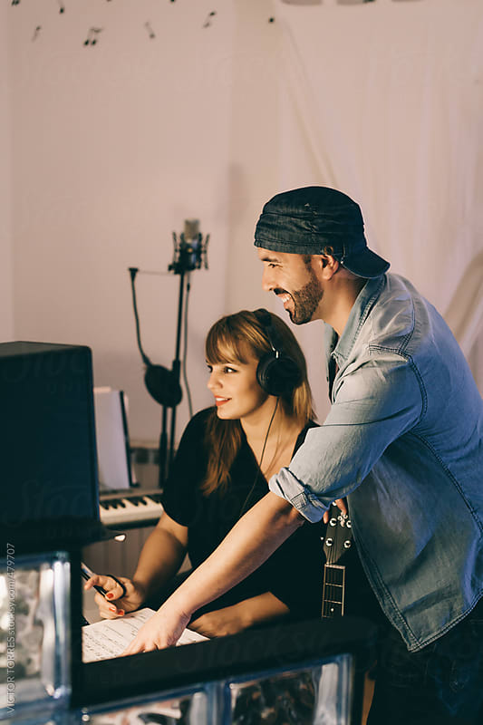Couple Producing Music in Their Home Sound Studio by VICTOR TORRES for Stocksy United