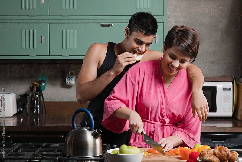 Couple cooking in kitchen by Andersen Ross Photography for Stocksy United