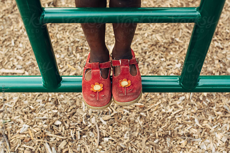 Black girl's feet climbing at a park by Gabriel (Gabi) Bucataru for Stocksy United