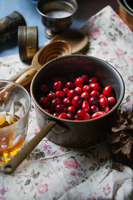Cranberries in a pot. by Darren Muir for Stocksy United