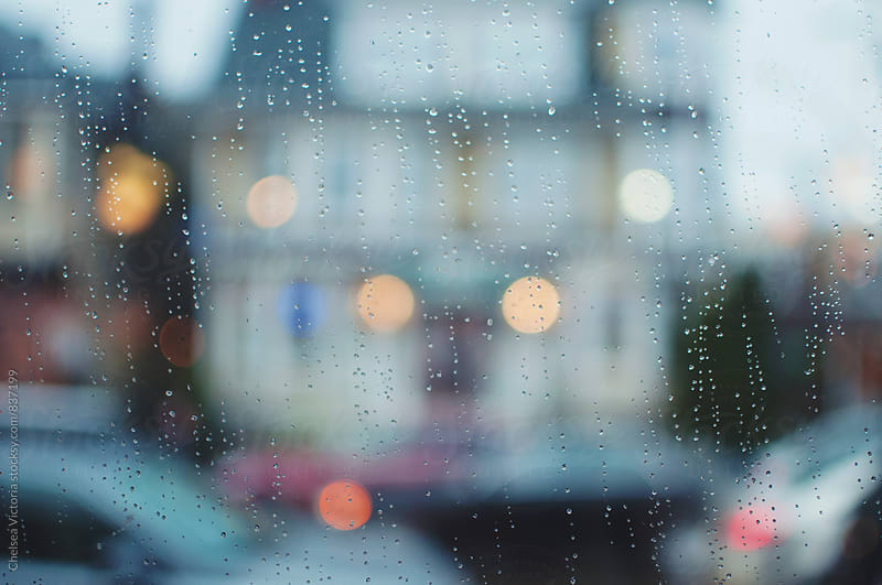 Traffic passing by from a rainy window by Chelsea Victoria for Stocksy United