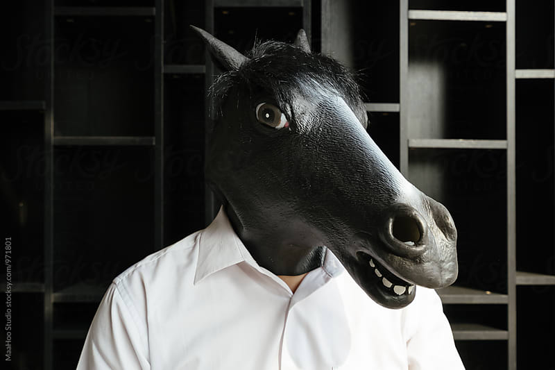 Man with horse mask by Maa Hoo for Stocksy United
