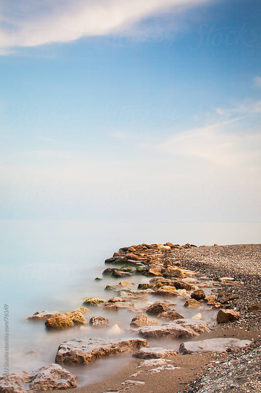 Breakwater of rocks in Algarrobo costa, Malaga, Andalusia by ACALU Studio for Stocksy United