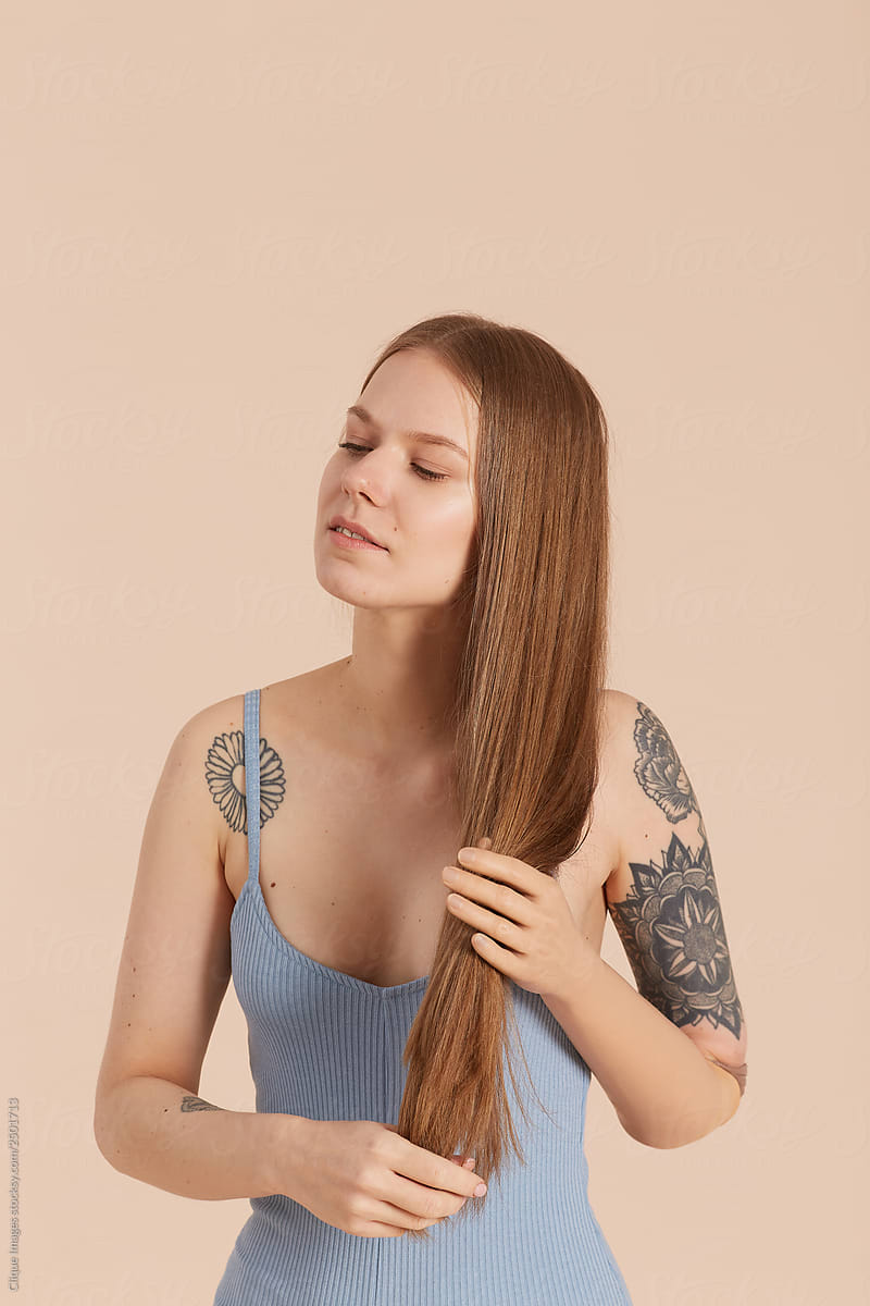 Young Woman Touching Her Hair by Clique Images - Arm, Amputee